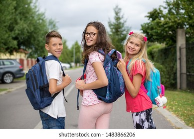 Elementary-age children, friends on street  going back to school