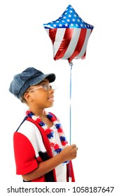An elementary-aged patriot wearing red, white and blue happily holding a patriotic star-shapped balloon.  On a white background.