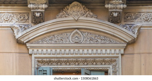 Elements of architectural decoration of buildings, cornices over windows and doors, balconies and arches, patterns and stucco molding. On the streets in Catalonia, public places.