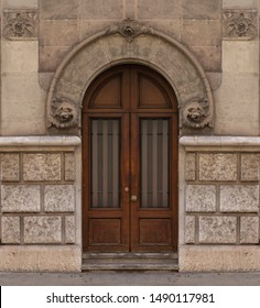 Elements of architectural decoration of buildings, old doors and arches, lattice gates and patterns on the streets in Barcelona, public places.
