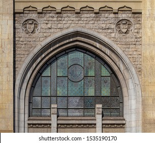 Elements of architectural decoration of buildings, old windows and arches on the streets in Barcelona, public places. Windows of ancient buildings decorated with stucco.