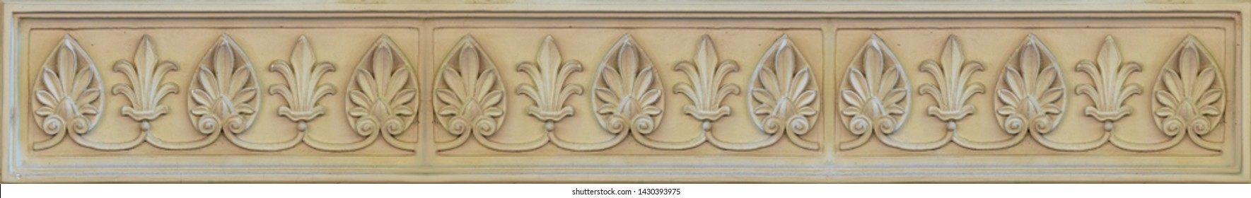 Elements of architectural decoration of buildings, plaster stucco, wall texture, plaster molding and patterns. On the streets in Georgia, public places.