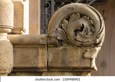Elements of architectural decoration of buildings, stucco patterns with flowers, gypsum ornaments and wall textures. On the streets in Barcelona, public places.