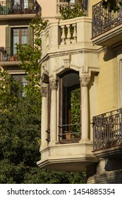 Elements of architectural decorations of buildings, balconies and windows, arches and balustrade, gypsum patterns and stucco. On the streets in Catalonia, public places.