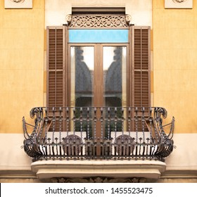 Elements of architectural decorations of buildings, balconies and windows, metal railings and balustrade. On the streets in Catalonia, public places.