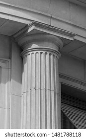 Elements of architectural decorations of buildings, columns and capitals, gypsum moldings, wall textures and patterns. On the streets in Georgia, public places. Black and white retro style photo.