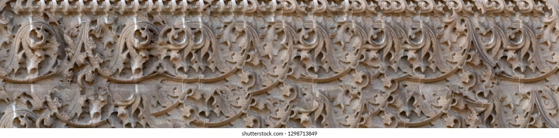 elements of architectural decorations of buildings, gypsum stucco, texture of the wall plaster and patterns, on the streets in Catalonia, public places.