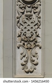 Elements of architectural decorations of buildings, gypsum stucco, wall texture, plaster columns and patterns. On the streets in Georgia, public places.
