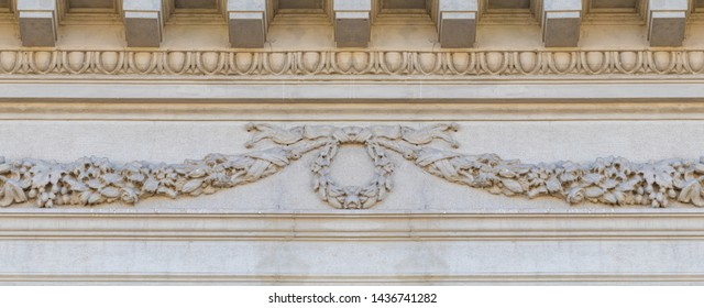Elements of architectural decorations of buildings, gypsum stucco, wall texture, plaster ornaments and patterns. On the streets in Georgia, public places.