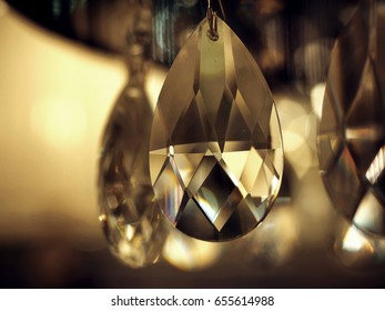 Elements crystal under the light of chandelier, Luxury and urban design round glowing light background.