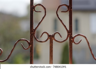 Elements of decor of metal grilles on windows
