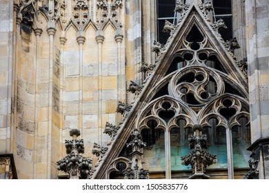 Elements of Gothic architecture. Gable wall rose(rosette) windows on the facade. Pinnacles, crabbs and other chiseled stone of an ancient medieval cathedral. St. Stephen's Cathedral. Vienna. Austria
