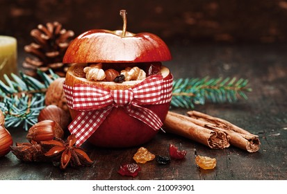 Elements Inside Red Christmas Apple Tied with Red and White Ribbon.