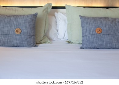 Elements of interior of a modern bedroom, clean bed linen and pollows