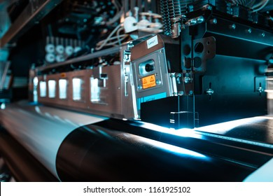 Elements from the production chain within a massive printing facility, newspaper, magazine, billboards, and any commercial print is made here.