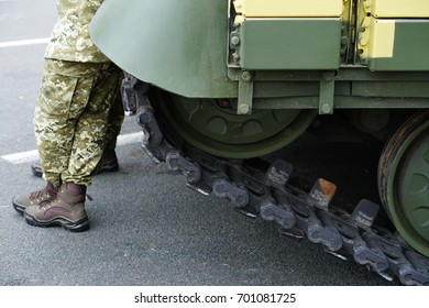Elements of the running gear of a military vehicle. Background. Close-up