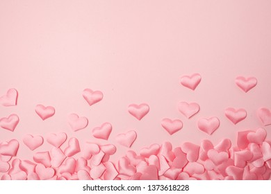 elements in shape of heart flying on pink background. symbols of love for Happy Women's, Mother's, Valentine's Day