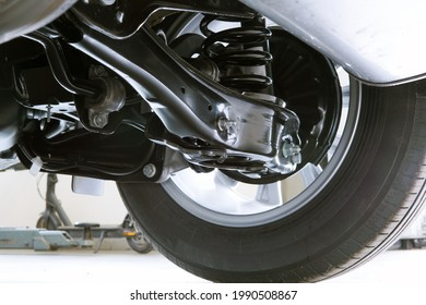 Elements and structure of the suspension of a modern car. Service, spare parts, car repair.