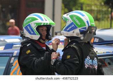 ELENA, VELIKO TARNOVO PROVINCE, BULGARIA - JULY 17, 2016: Women car racers get ready for the race