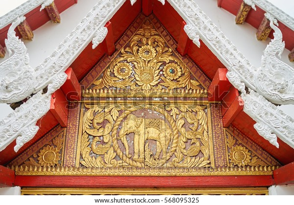 Elephant carved on wood at roof of Wat in Phrae, Thailand