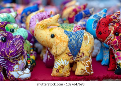 Elephant doll for sell in street market, Thailand. Souvenirs for tourists at market , close up