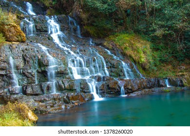 Elephant falls located near Shillong peak in Meghalaya , India is named so by the British due to a stone present in elephant shape. The stone was destroyed in 1897 earthquake but the name remained.
