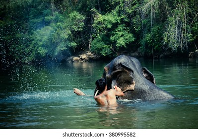 Elephant with mahouts Bathing in river