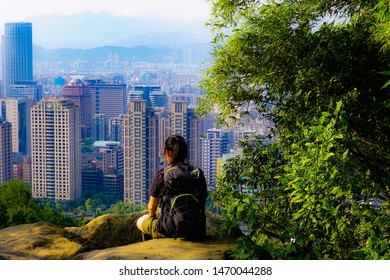 Elephant Mountain, Taipei, Taiwan - March 2019: Overlooking the city from on top of the mountain