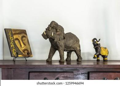 elephant ornaments on a wooden desk