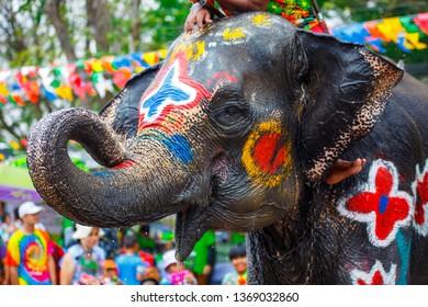 Elephant with people splashing water during Songkran Festival in Ayutthaya, Thailand