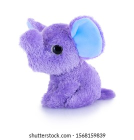 Elephant plushie doll isolated on white background with shadow reflection. Plush stuffed puppet on white backdrop. Purple or violet fluffy elephant toy for children. Cute furry animal plaything.