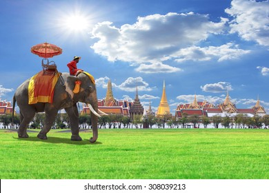 Elephant an ride tour for tourists of the grand architecture, a venue now mostly used for ceremonial events. The Buddhist temple of Wat Phra Kaeo at the Grand Palace in Bangkok, Thailand