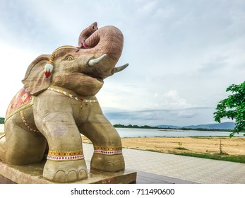 Elephant sculpture of a beautiful ivory and white trunk, Elephant pointing the blue sky graceful.