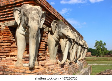Elephant sculptures ,Wat Sorasak ,Sukhothai Historical Park ,Thailand ,world heritage. The main bell-shaped chedi sits on a base of elephant sculptures.