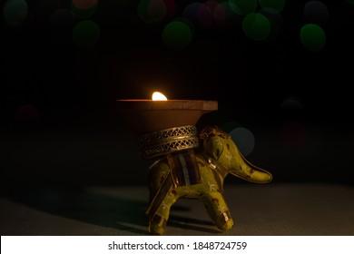elephant shape Diwali Diya(oil lamp) stand in selective focus. Diwali is biggest festival of India. Diwali is festival of lights and happiness.