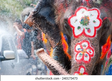 Elephant splashing water during Songkran Festival on Apr 14, 2014 in Ayutthaya, Thailand.  Initiated by Tourism Authority of Thailand, elephants take part in the festival to give revelers more fun.