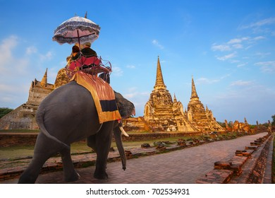 Elephant with Tourist at Wat Phra Si Sanphet temple in Ayutthaya Historical Park, a UNESCO world heritage site, Thailand