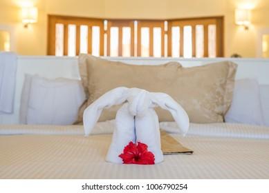 Elephant towel on bed