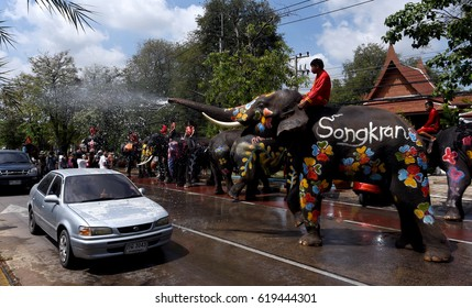 Elephants splash water to vehicles during Songkran festival in Ayutthaya province on April 11, 2017.
