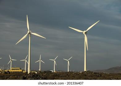Eletric Power Generator Wind Turbine over a Cloudy Sky