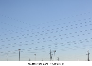eletric tellis pylon tower and wires on a blue sky