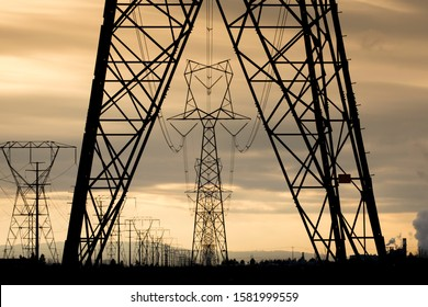 Eletrical towers and power lines close to sunset in north Idaho.