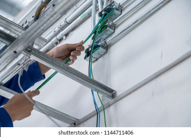eletrical wiring work workmen do wiring tube site construction concept