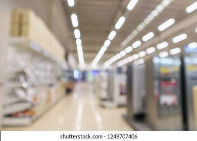 eletronic department store in supermarket shopping mall show Television TV refrigerator and home appliance with bokeh light blurred background