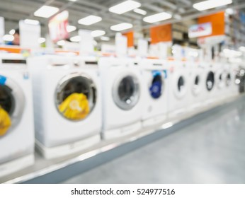 eletronic department store with washing machines blurred background