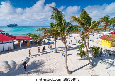 ELEUTHERA, BAHAMAS - DECEMBER 7: Tourists enjoy a sunny day on the sandy beach of Princess Cays, Eleuthera in the Bahamas on December 7, 2011.
