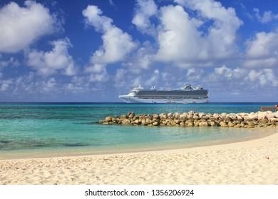 ELEUTHERA, BAHAMAS - FEBRUARY 9, 2014 : View from Eleuthera beach on Crown Princess ship anchored at sea.