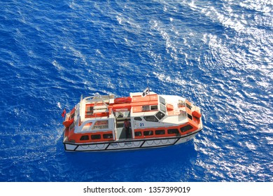 ELEUTHERA, BAHAMAS - FEBRUARY 9, 2014 : Lifeboat of Crown Princess ship at sea transports passangers ashore. Crown Princess is a Grand-class cruise ship owned by Princess Cruises.