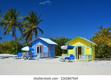 ELEUTHERA, BAHAMAS - MARCH 21, 2017 : Colorful bungalows by the ocean on the Eleuthera island beach.