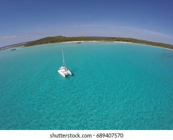 Eleuthera, Bahamas - Sailing catamaran at anchor in crystal clear water